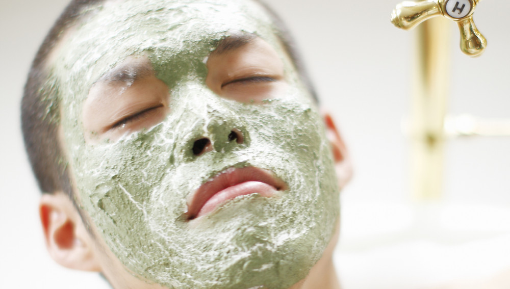 man with green face mask on looking extremely relaxed