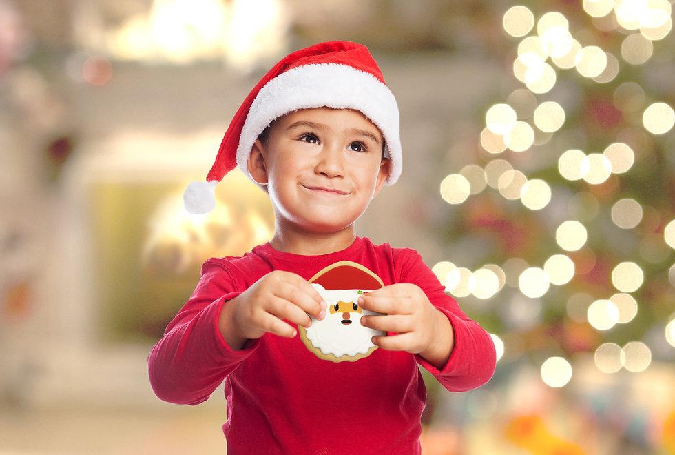 2019_Christmas_BoyHolding_SantaCookie_Ne
