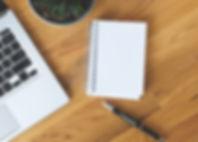blank-notepad-on-a-desk.jpg