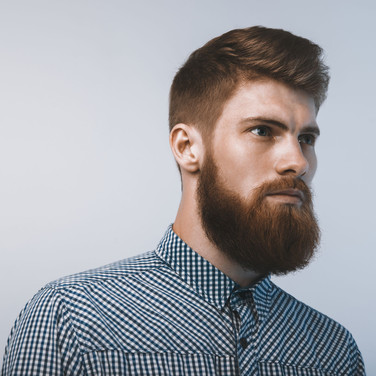 Man with short auburn hair and full beard