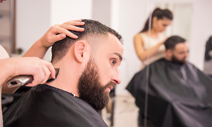 A man having his hair cut with clippers