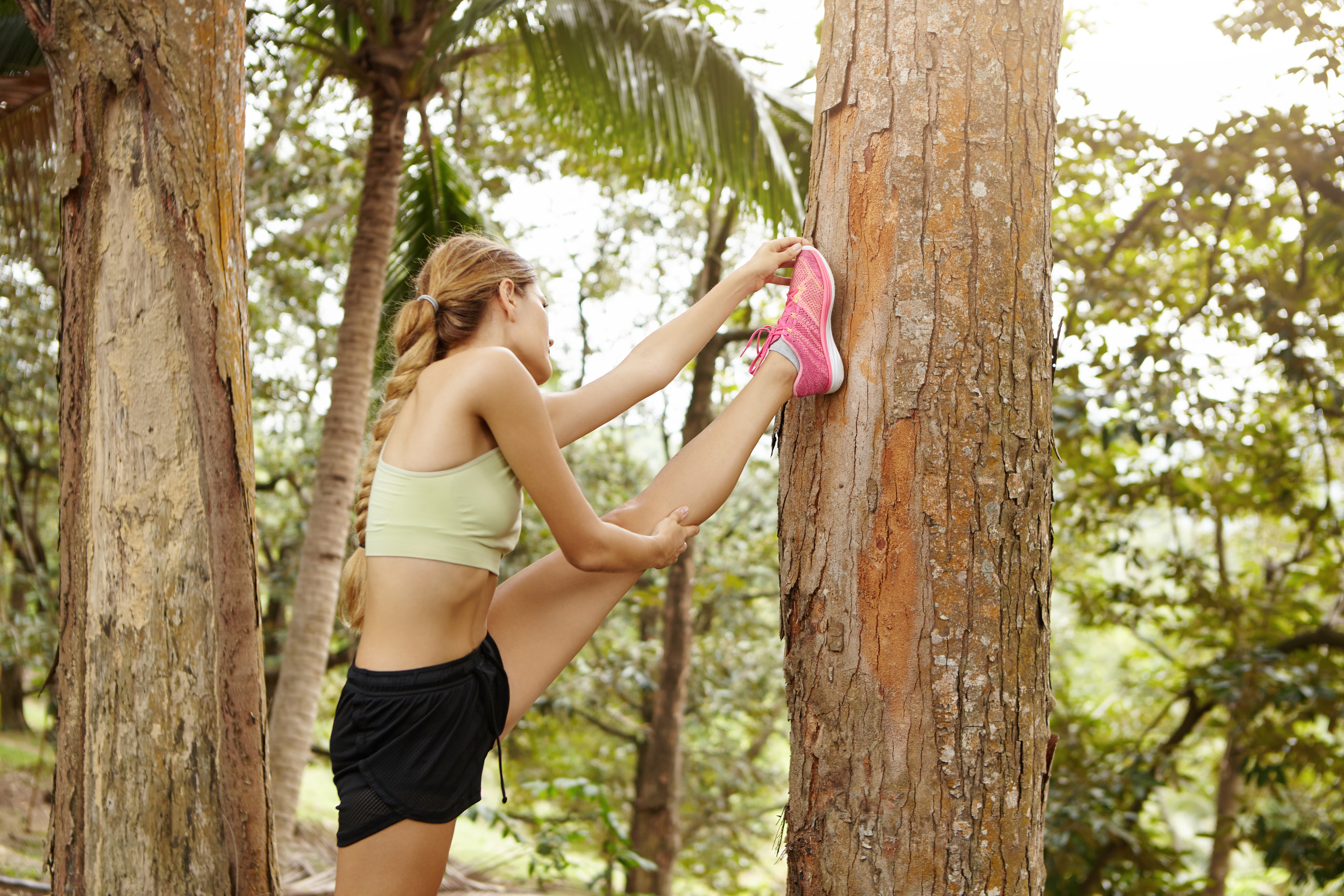 Girl Stretching in Forest