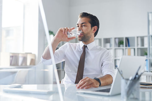 thirsty-young-broker-having-glass-of-wat