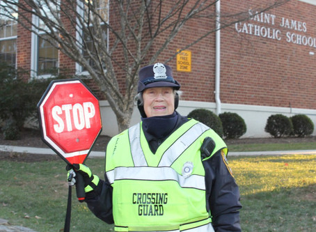 Crossing Guard Holding Our Original LED Stop Sign Retires