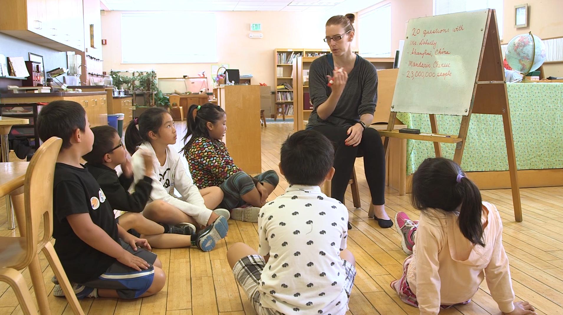 Students gathered around a teacher