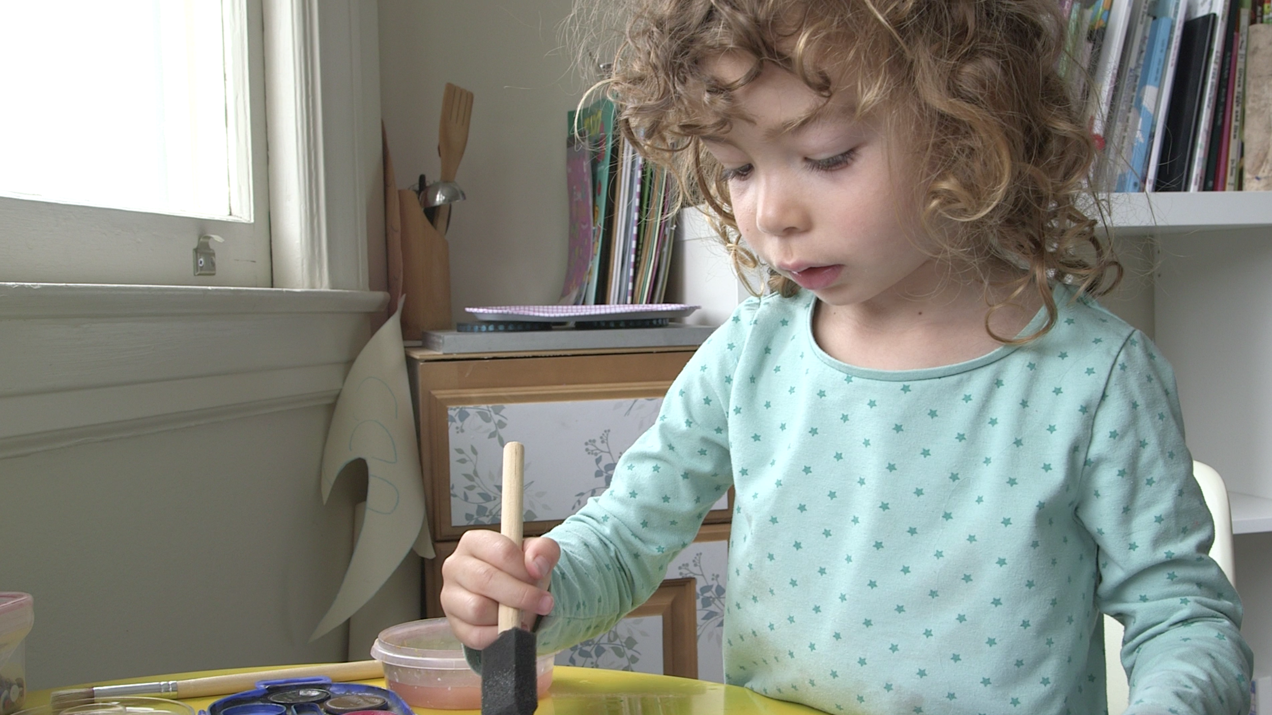 Child painting at a table