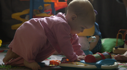 Infant playing with electronic toy