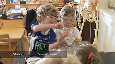 Two Montessori elementary student conduct a science experiment
