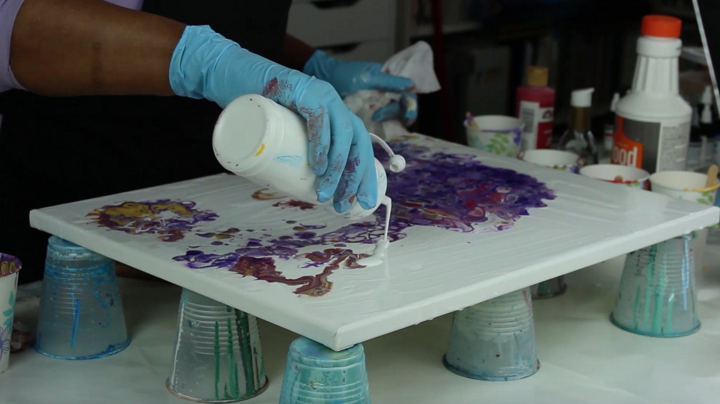 Artist is pouring white paint