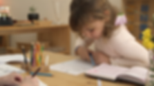 A Montessori elementary student practices creative writing and illustration at Mission Montessori in San Francisco, CA