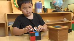 Montessori student doing trinomial
