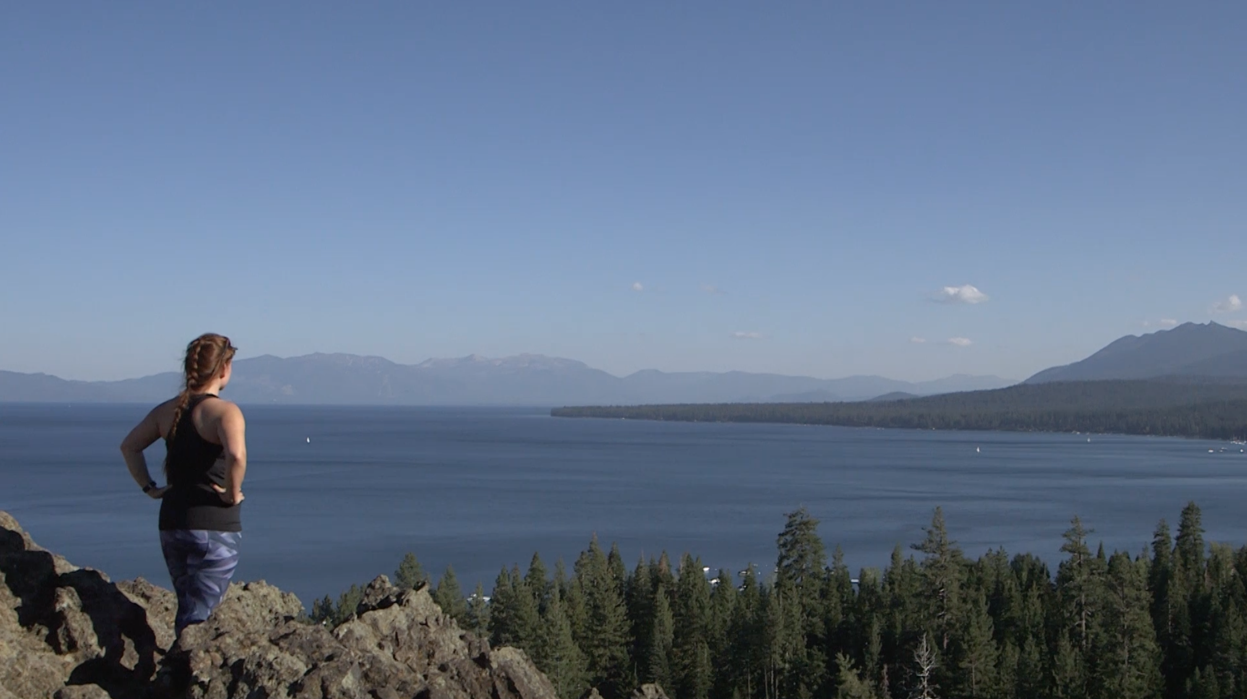 Woman gazing out over Lake Tahoe, CA
