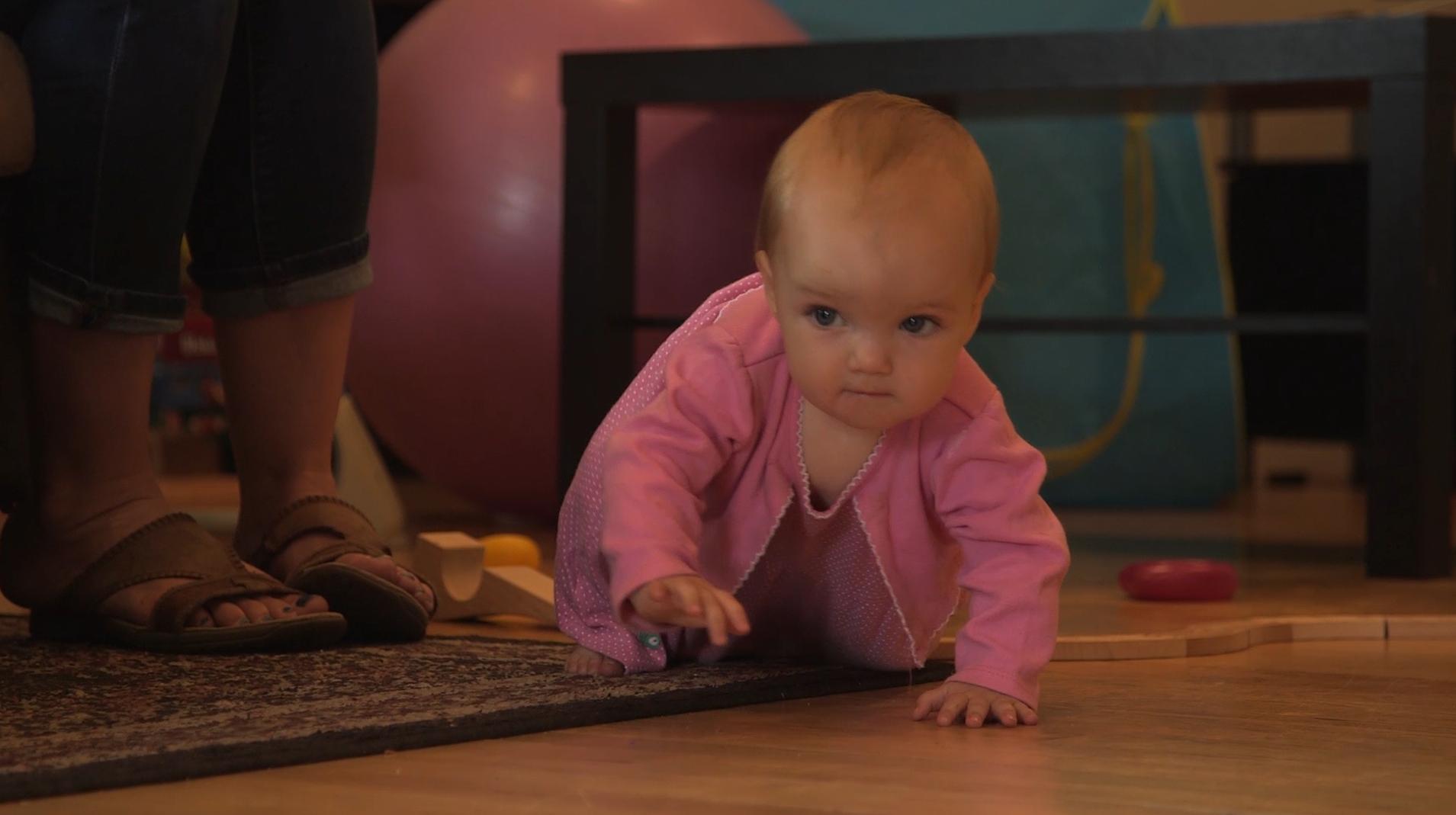 Baby crawling across floor