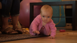Baby crawling across floor