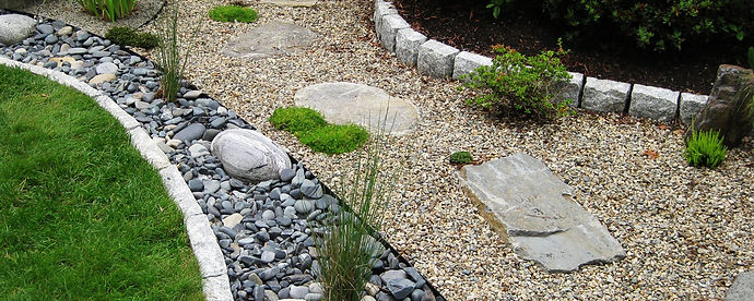 One way to resolve water flow issues is to build a dry creek bed. Dry creek beds can redirect water, help prevent erosion and resolve drainage issues. Not only are they functional but they have become somewhat of a desirable hardscape addition, being very attractive in their own right.