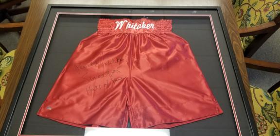 Pernell Whitaker Signed Boxer trunks in frame