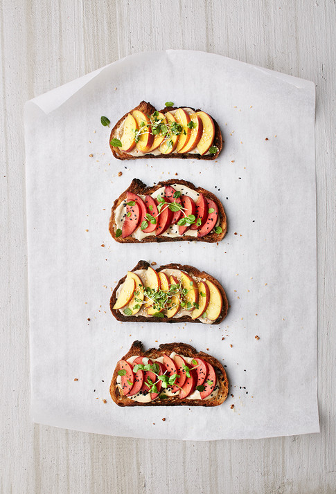 tahini toasts with stone fruit & heirloom spouts