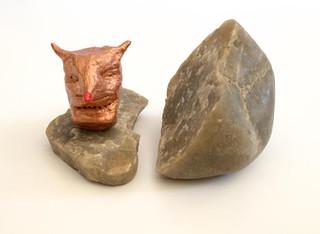 split rock with copper head inside