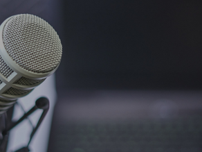What We're Listening To: Favorite Podcasts