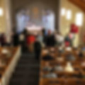 Congregation at communion.jpg