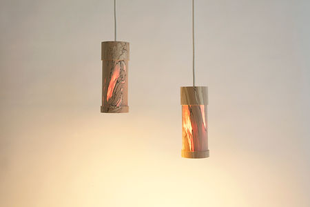 The Pendant Lights designed by Milo Dool. These lamps are made out of spalted wood that is made very thin so that it becomes translucent for beautiful ambient lighting.