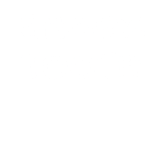 Shark Tooth Logo White.png