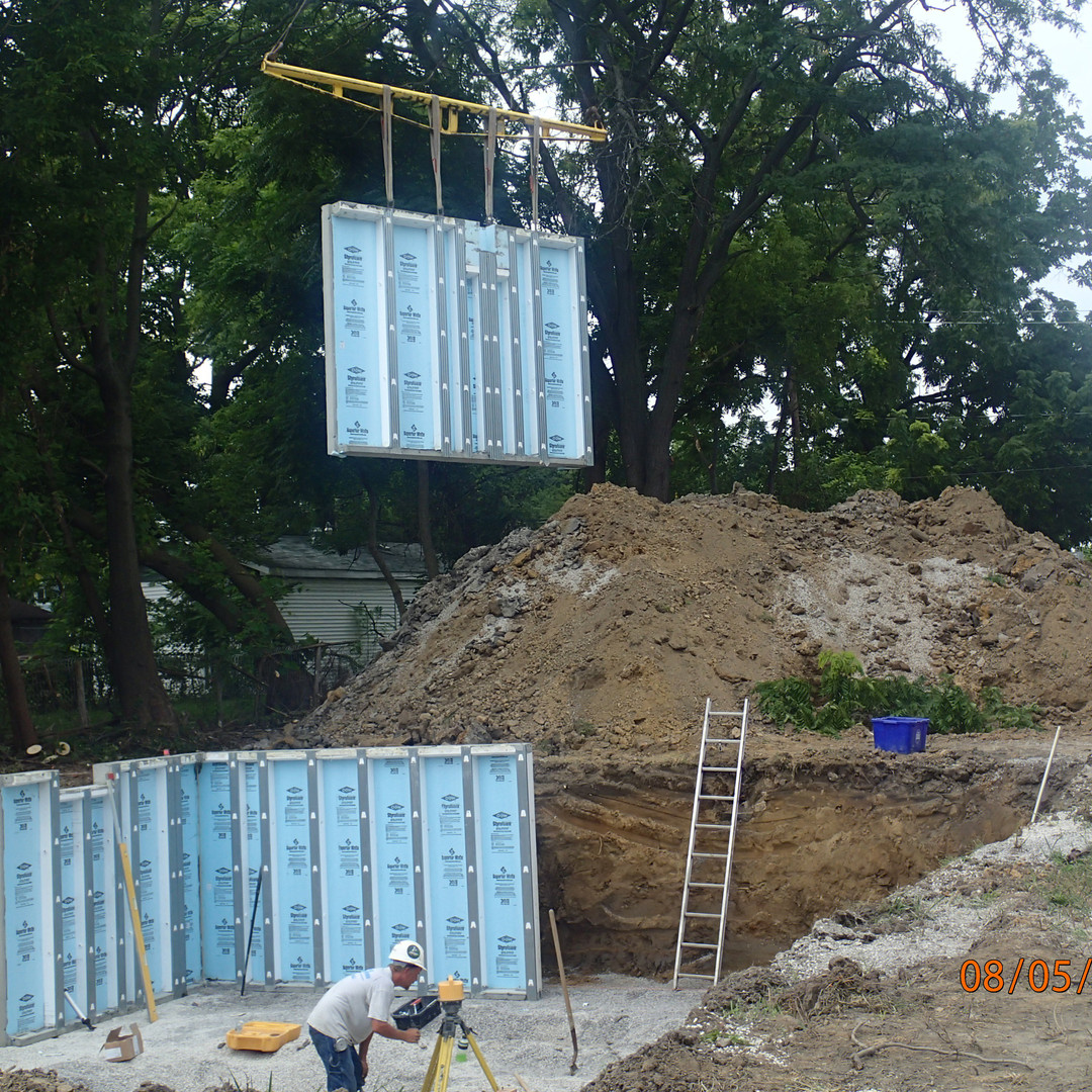 Panelized bsmt walls being set.JPG