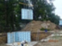 Panelized bsmt walls being set.JPG