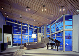 contemporary living room in blues and wood with grand piano.jpg