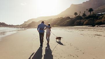 Mature couple strolling along pismo beach
