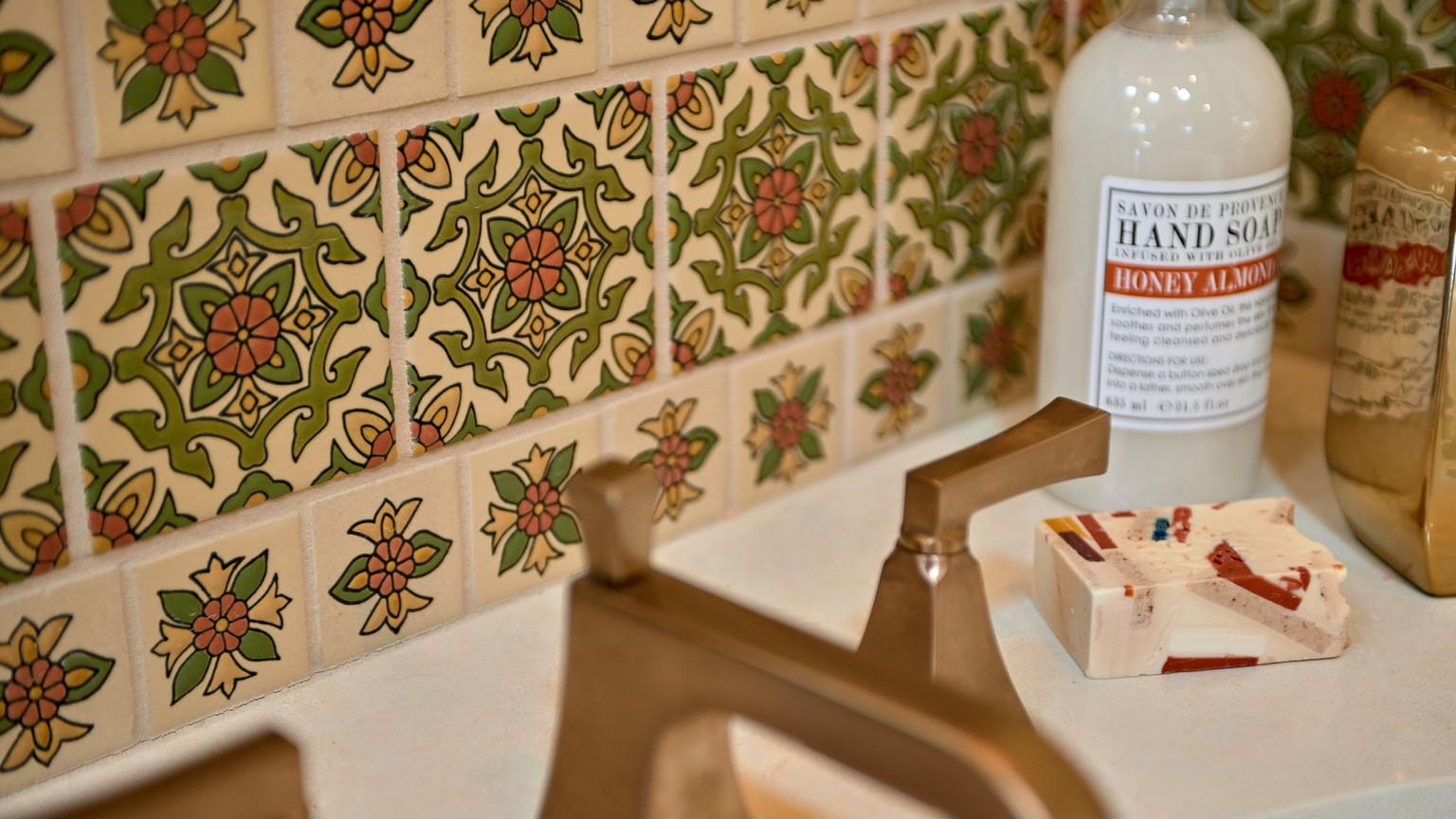 green oand orange painted spanish tiles in bathroom backsplash.jpg