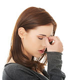 Young woman with sinus pressure pain.jpg