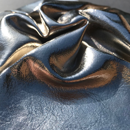 Detail of leather metal fold tile