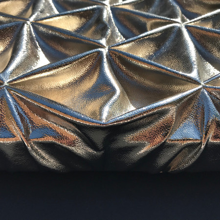 Diamond smocked leather textured metal panel