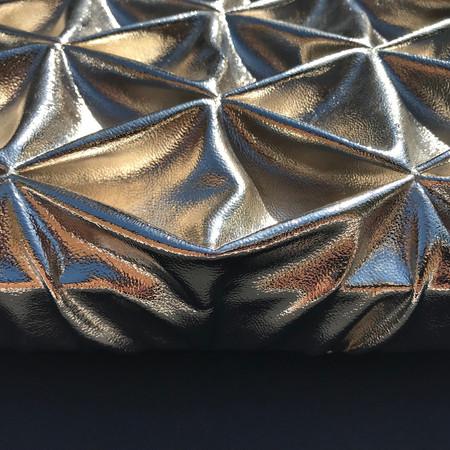 Diamond smocked leather textured metal panel
