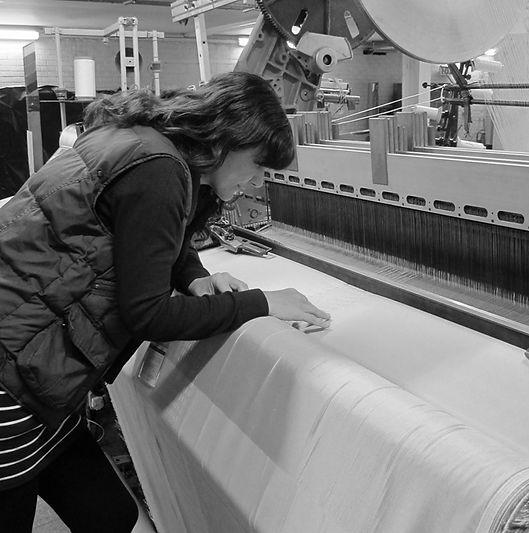 Dr Hannah White designing at UK weaving