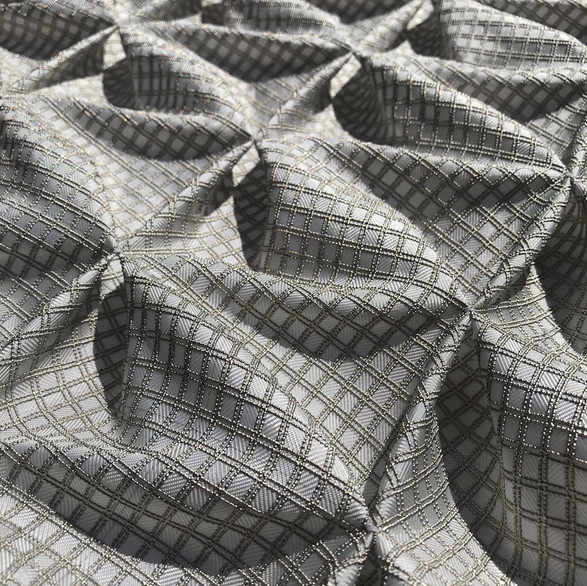 Woven metal grid scultpural panel