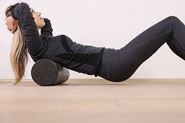 Woman doing balance foam roller exercise
