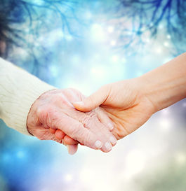 Holding hands with elderly on a blue nig