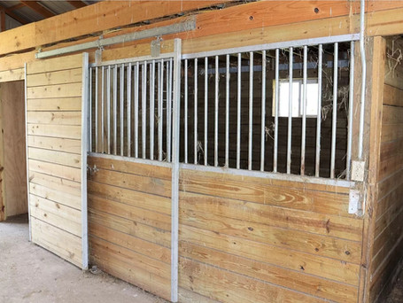 Different stalls in a separate barn