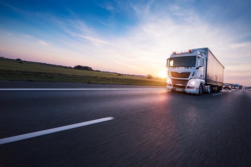 Loaded European truck on motorway in bea