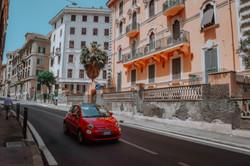 red-5-door-hatchback-on-a-narrow-street-