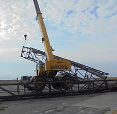 Our crane putting up a leg tower