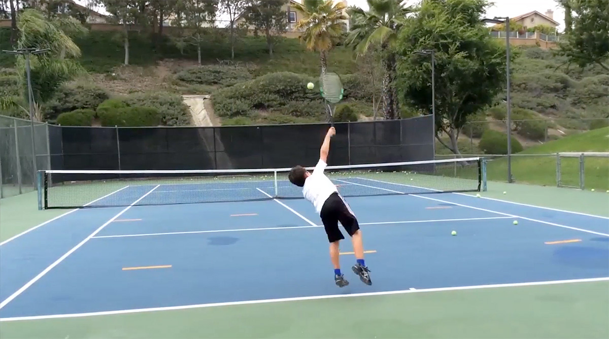 A Junior Perfecting His Serve