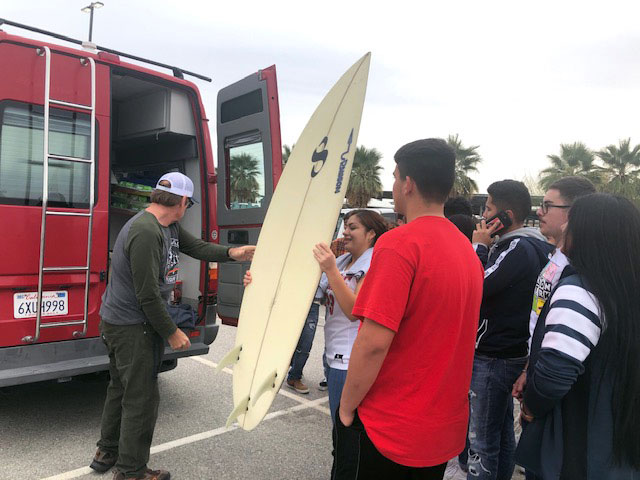 Unloading Surfboards and Wetsuits at Desert Mirage High School