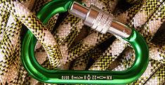 Green locking carabiner and braided kernmantel climbing rope