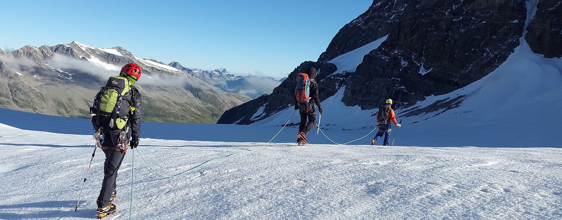 Mountaineers roped up on glacier travel during mountaineering expedition