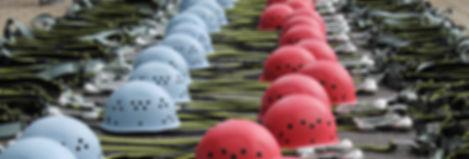 Rock climbing helmets and technical gear displayed for an outdoor program risk management assessment