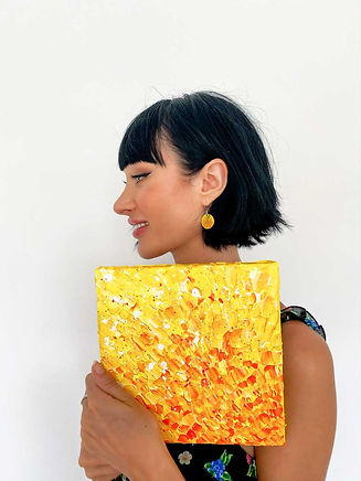Bridget B Artist wearing her 'Heart fo the Sun' Sterling Silver Earrings from her exclusive jewellery collection