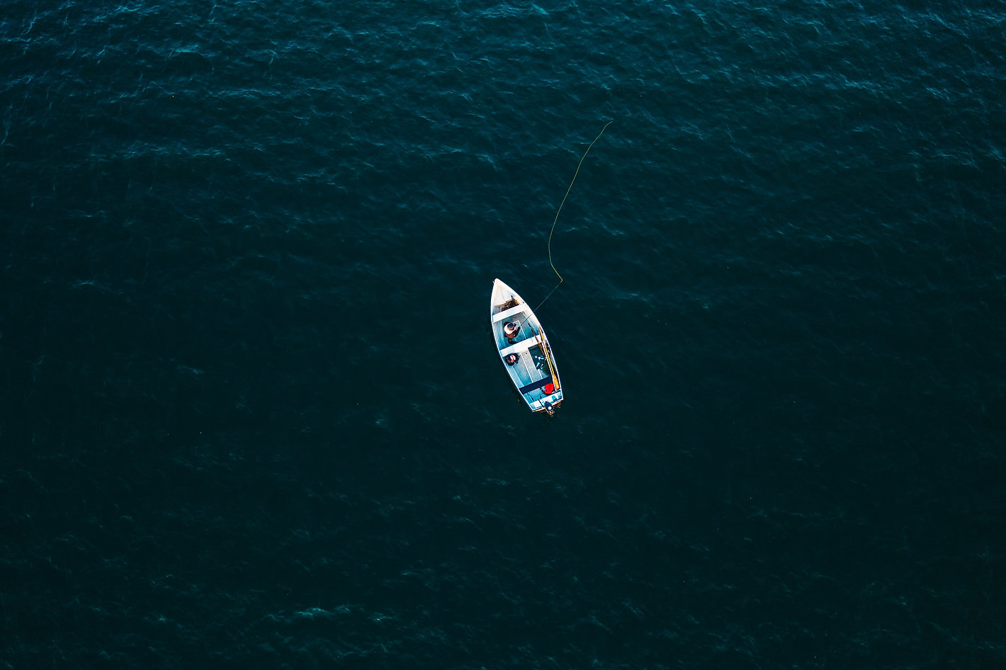 top-view-photo-of-boat-on-ocean-3030045.